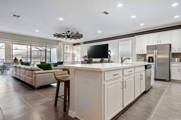 The kitchen features a marble counter island