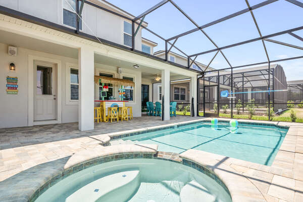 Choose to cool off in the pool or the spillover spa