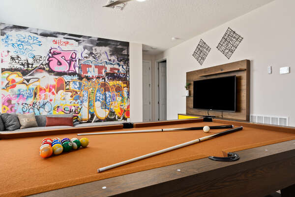 Play pool in the upstairs den