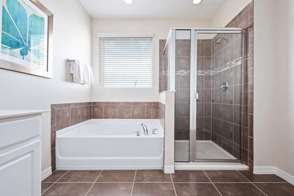 Includes a garden tub and a walk-in shower