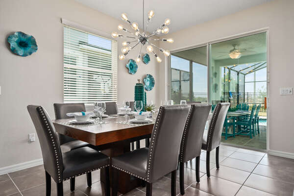 The formal dining table has seating for up to 8 guests