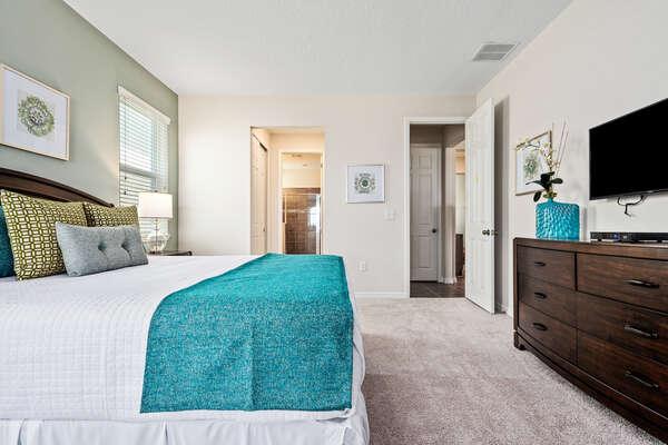 The bedroom has plenty of storage space