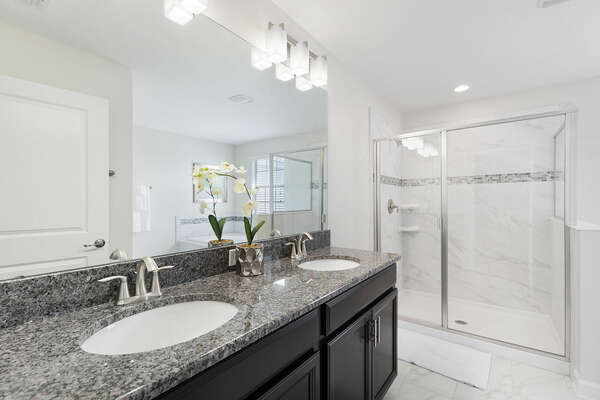 The en-suite bathroom has a walk in shower, garden tub, and dual vanity