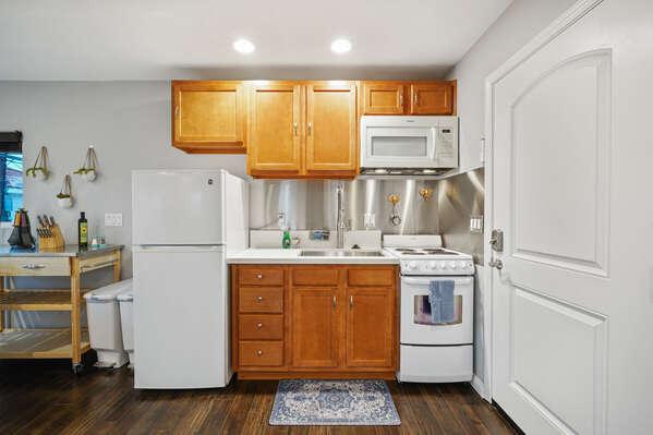 Kitchen and Doorway to Roof Deck - Second Floor