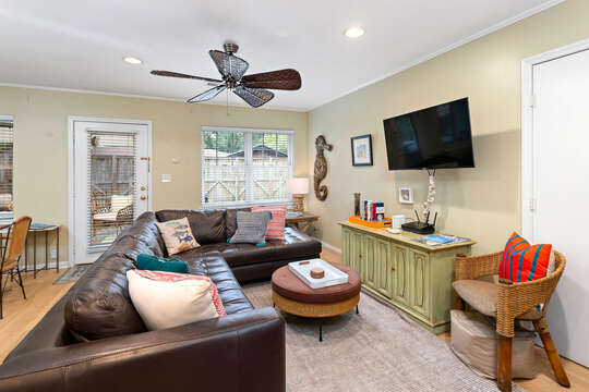 Modular Sofa, Coffee Table, Ceiling Fan, TV, and TV Buffet Cabinet.