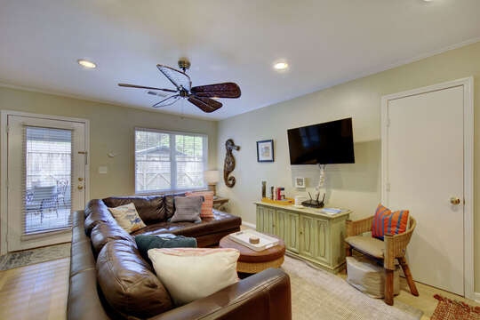 Sofa, Coffee Table, Chair, TV Buffet Cabinet, and Ceiling Fan.