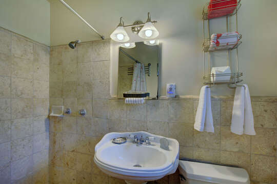 Pedestal Sink, Mirror, and Shower.