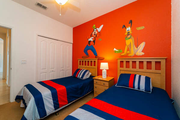 Bedroom 3 has twin beds and a Walt Disney theme