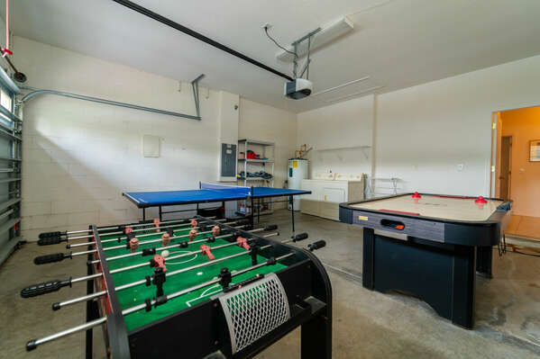 Garage has been converted to a games room with ping pong, air hockey and foosball.
