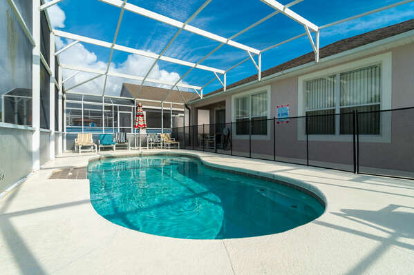 View of pool with baby safety fence in place