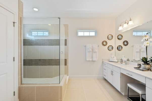 Walk-in shower and dual vanity with wall to wall mirror