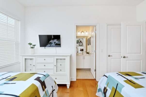 Bedroom features an ensuite bathroom and TV