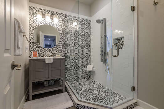 Remodeled Full Shared Bath with a Shower with Designer Tile, Dual Shower Heads and Multiple Jets
