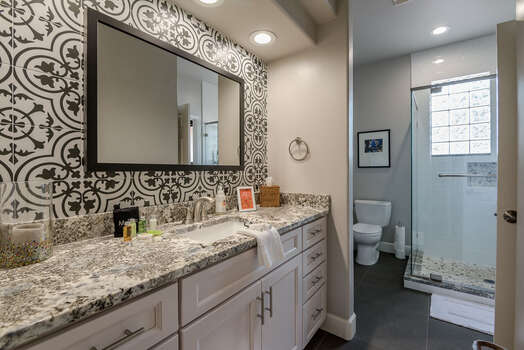 Remodeled Full Shared Bath with Stunning Tile, Shaker Cabinets and a Granite Countertop