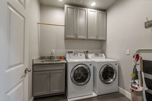 Laundry/Mud Room with a Sink, and a Front Load Washer and Dryer