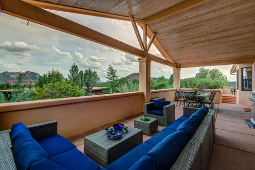 Large Back Patio with Plenty of Comfortable Seating and Outdoor Dining Area