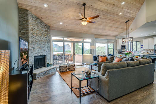 Spacious Living Room with Luxury Furnishings, Floor-to-Ceiling Stone Gas Fireplace, 60