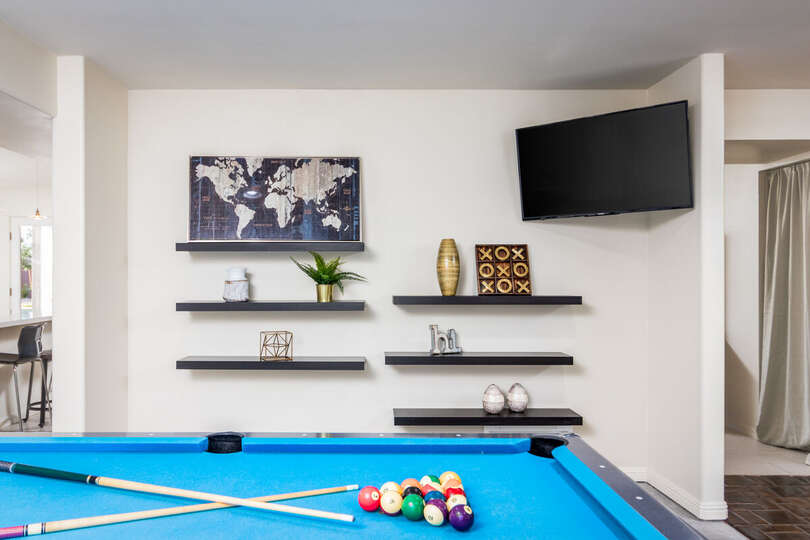 Game Room with Pool Table and TV of our Paradise Play Resort.