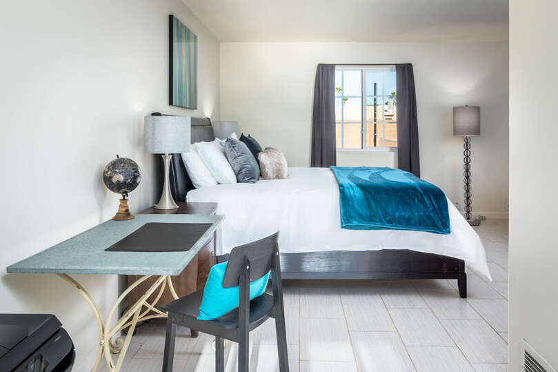 Bedroom with One Large Bed and Desk on our Resort Rental Scottsdale.