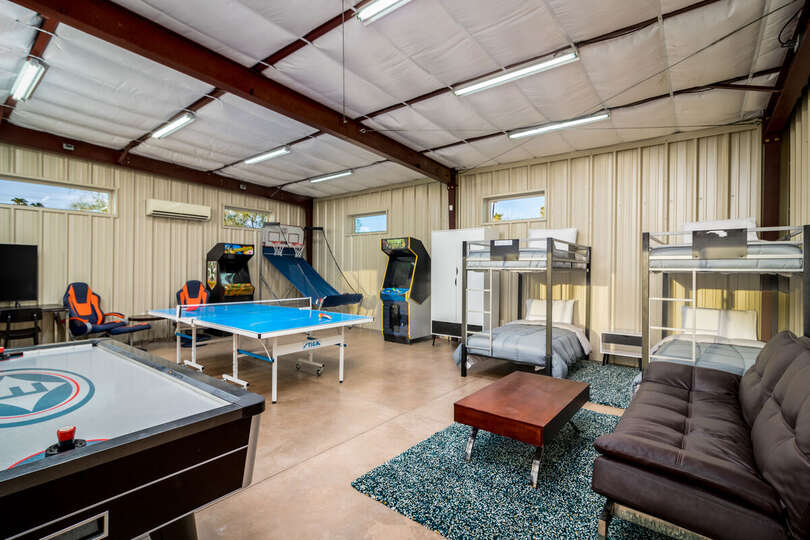 Air Hockey Table, Ping Pong Table, Sofa, and Two Bunk Beds.