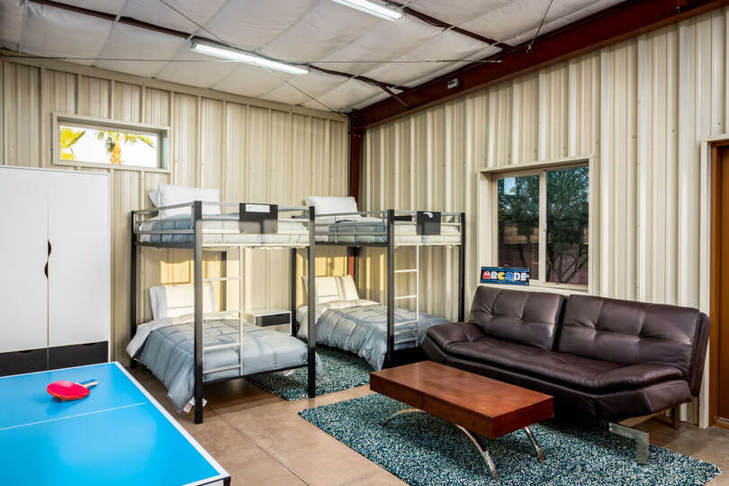 Two Bunk Beds, Wardrobe, Sofa, Coffee Table, and Ping Pong Table.