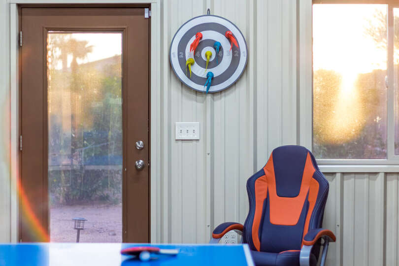 Dart Board Game, Ping Pong Table, and a Gaming Chair.