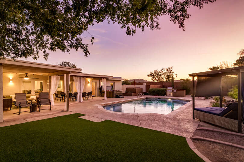 Picture of the Backyard with Pool at Sunset.