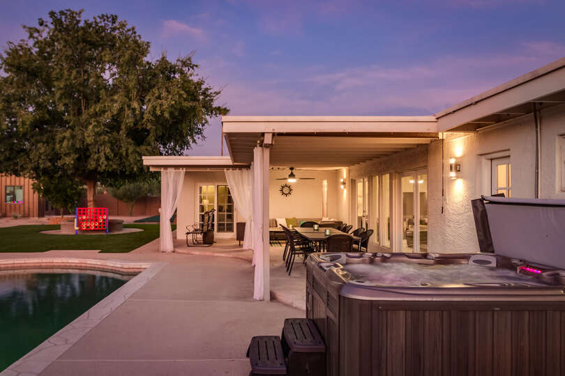 Jacuzzi, Pool, and Patio Table with Chairs.