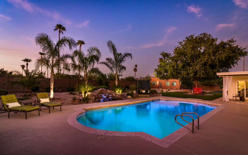 Backyard with Pool, Jacuzzi and Pool Chairs on our Resort Rental Scottsdale.