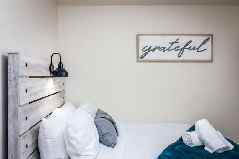 Closeup of One Bed and Modern Sign on the Wall.