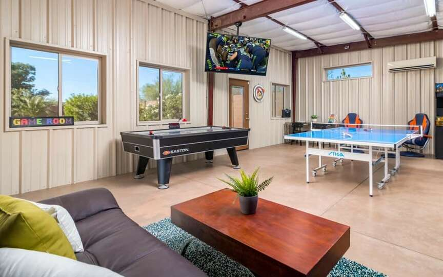 Coffee Table, Sofa, TV, Ping Pong Table, and Air Hockey Table.