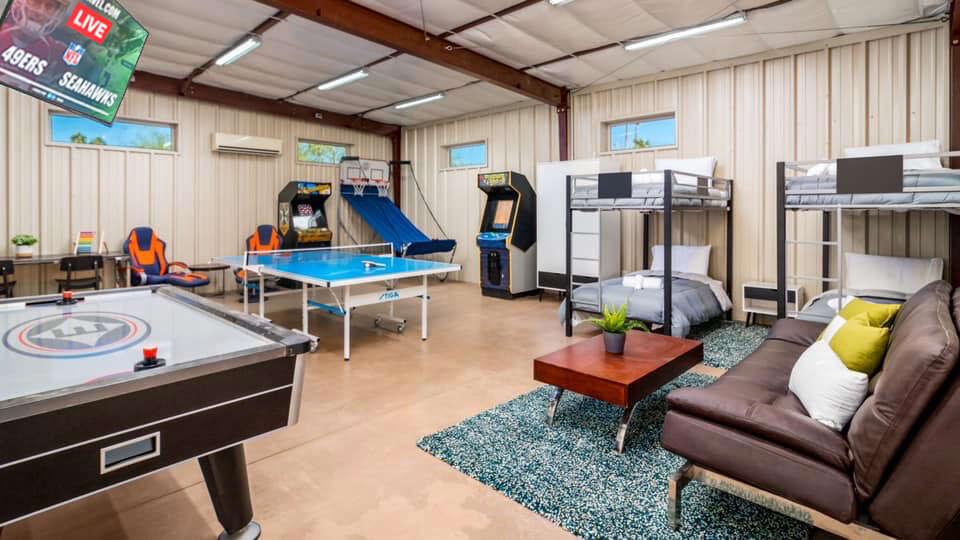 Arcades, Air Hockey, Ping Pong Table, TV, Bunk Beds, and Sofa.