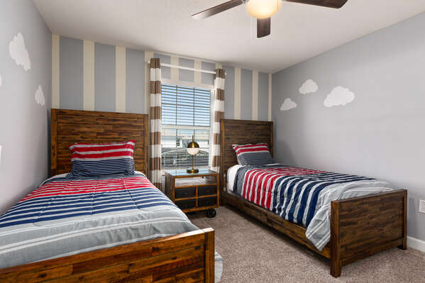 The fourth bedroom features 2 twin beds