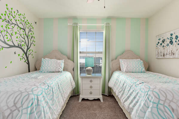 Kids will enjoy this room with 2 twin beds and intricate wall details