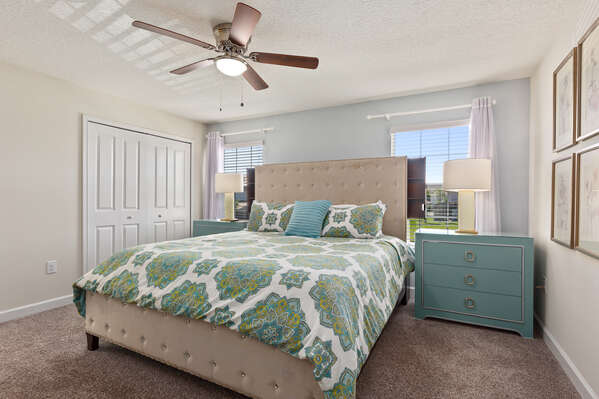 The second bedroom features a King bed, large closet and ceiling fan