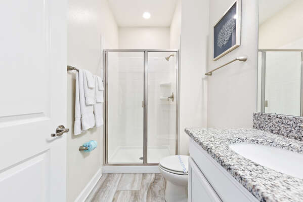 Get ready in the ensuite bathroom with a walk-in shower