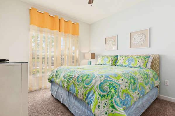 This master bedroom has a comfortable king bed