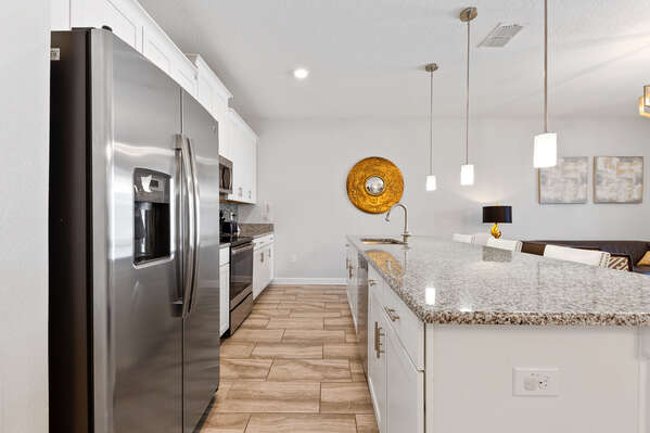 Stainless steel appliances make the clean up after a meal easy and give the kitchen a sleep appearance