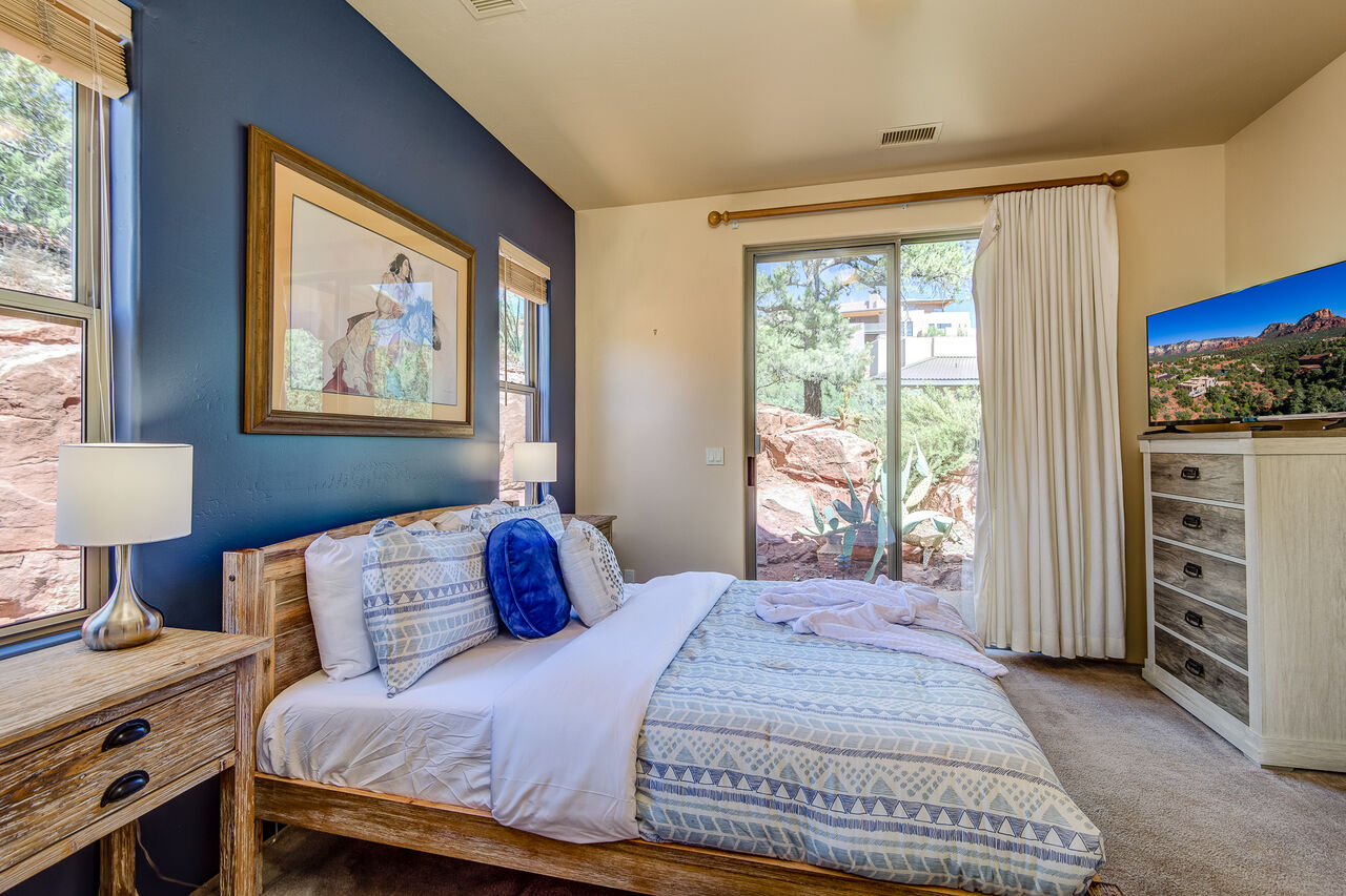 Main Level Bedroom 3 with a Full-size Bed with a Twin Trundle and Patio Access