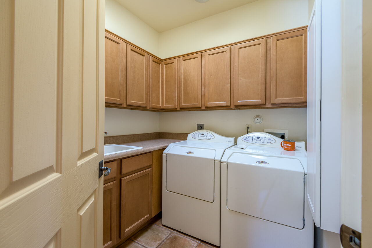 Laundry Room with a Sink and Full-size Washer and Dryer
