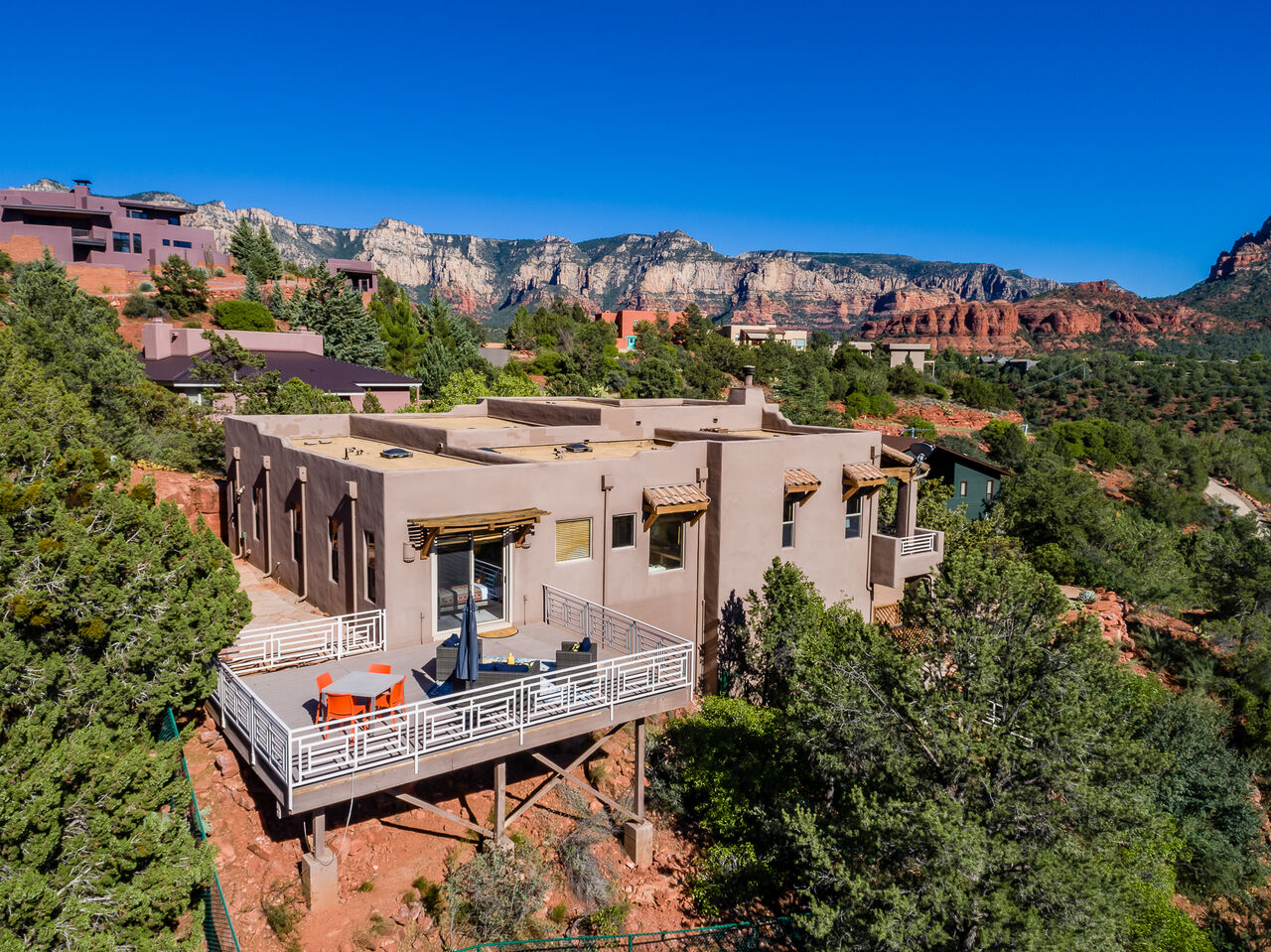 Situated on a Generous 0.56 Acre Lot that Borders the U.S. National Forest with Panoramic Views