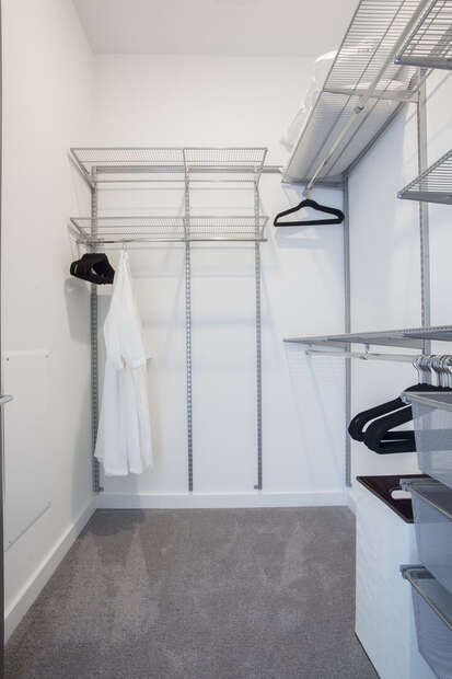 Master Closet Offers Guests Plenty of Space to Store Clothing.