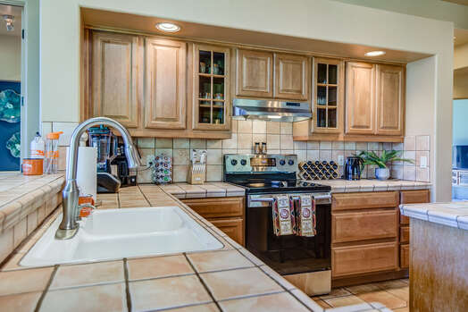 Spacious Kitchen with a 4-Burner Electric Range