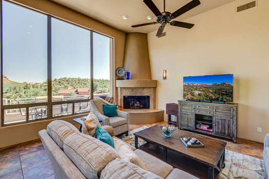 Very Comfortable Living Room with a Gas Fireplace, TV with Cable Programming,  and Expansive Views