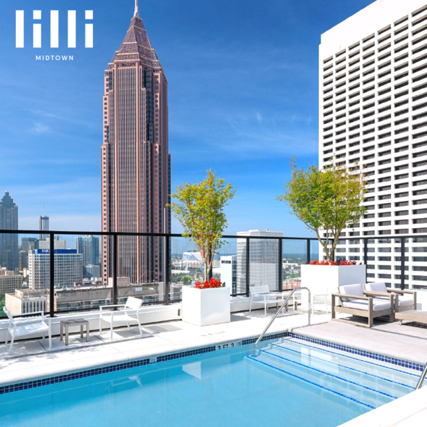 Image of Rooftop Pool and Surrounding Lounge Chairs.