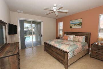 Master bedroom with king bed, TV and access to lanai