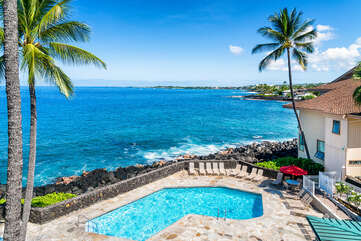View of the pool and ocean as seen from the lanai