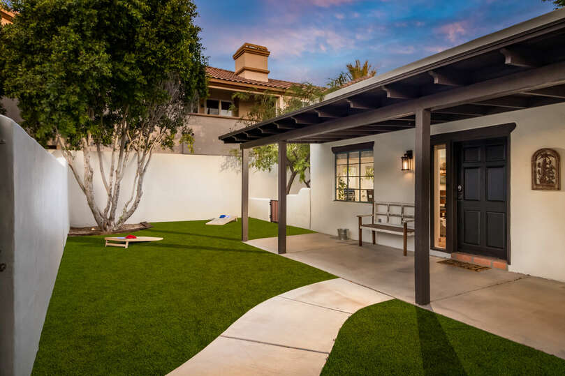 Enjoy Arizona nights in this luxurious yard with lawn games, hot tub, lounging, and, heating.
