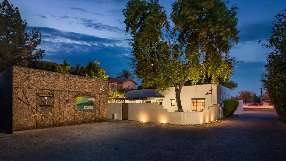 Private driveway with art and private backyard.
