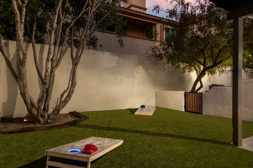 Enjoy lawn games in this private backyard.